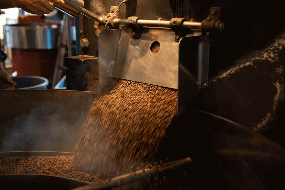 Coffee beans being processed at Jittery Joe's.