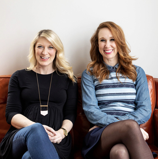 A photo of Karen McKenzie and Scarlett Rosier sitting on a couch together.
