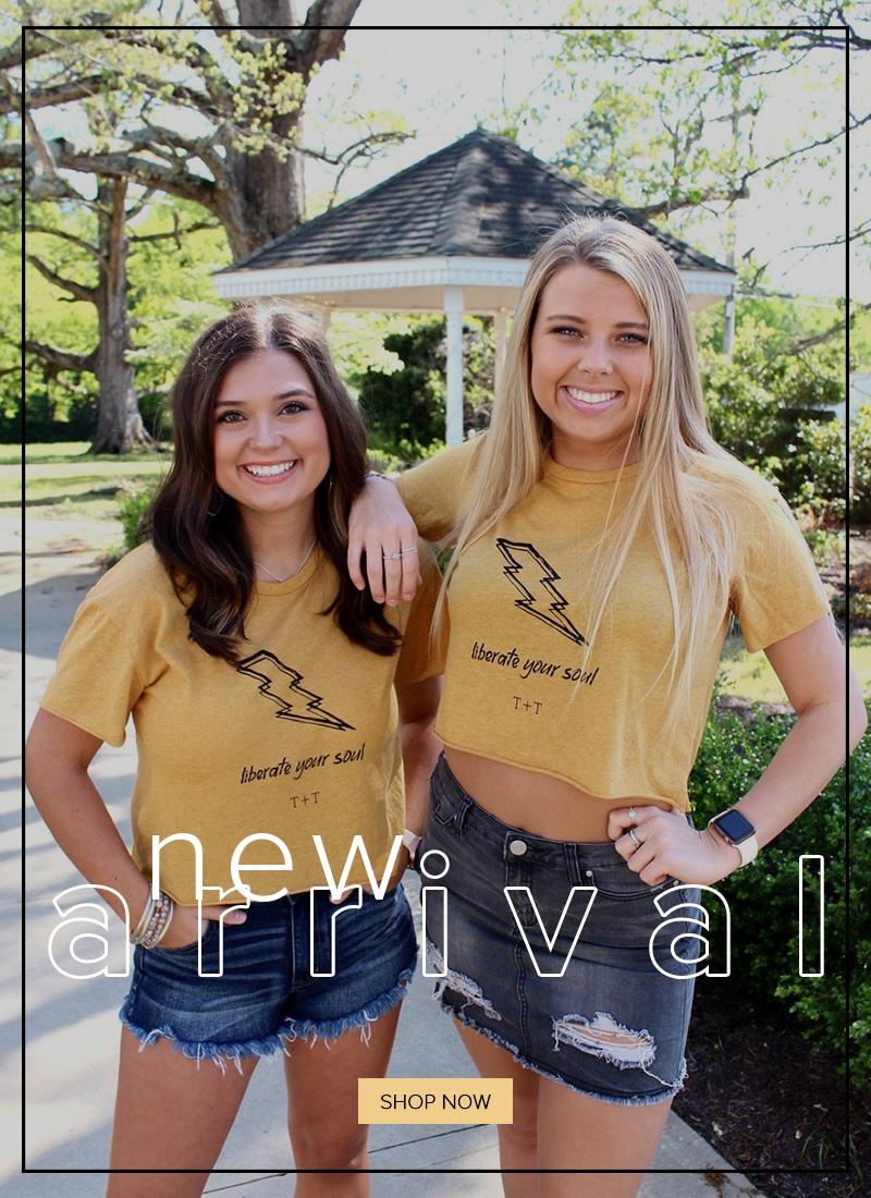 two women modeling t-shirts