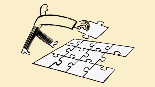 A person putting a puzzle together