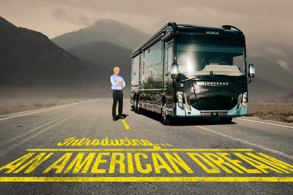 """Image of a man standing next to an RV on the road and the words """"Introducing an American Dream"""""""
