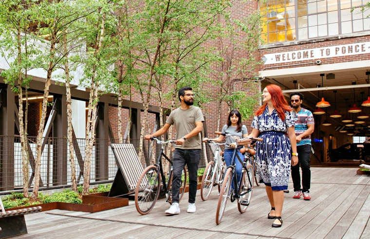 A few Mailchimp employees taking company bicycles out to ride
