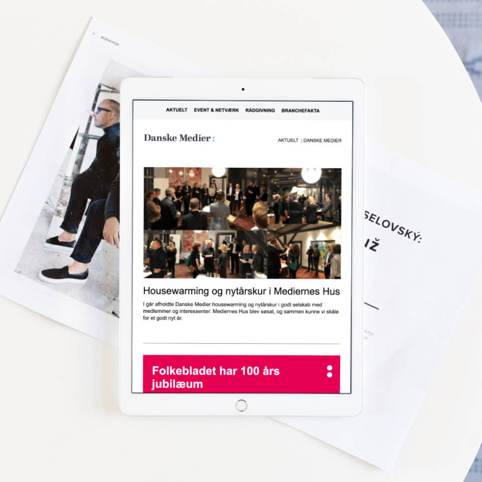 Bird eye view of tablet displaying newsletter template