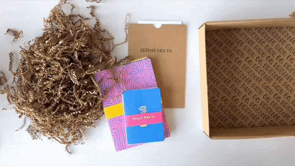 Meg is packaging some notebooks into a box