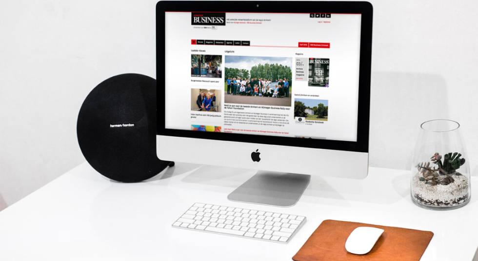 Desktop displaying website on desk.