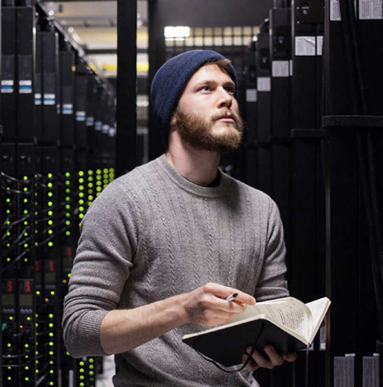 A photo of a man in a data center.