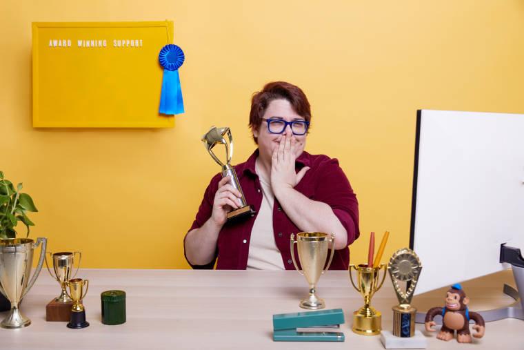 Mailchimp support team member accepting an award