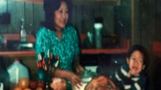 Ben Chestnut as a child with his mother in the kitchen