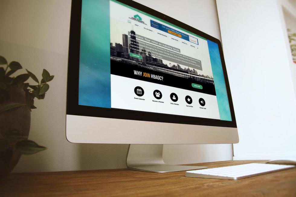 Photo of Macbook desktop displaying website homepage.