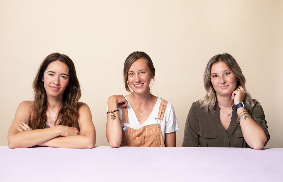 A photo of freelancers Marcy Chu, Paige Slaughter, and Mari Backus sitting together at a table.