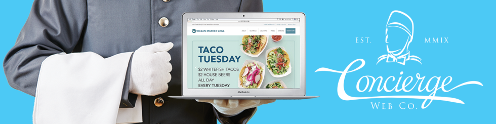 Horizontal image header showing waiter holding an open laptop which displays custom website.
