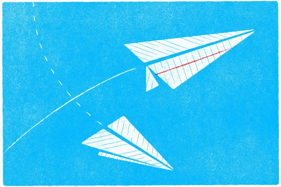 A couple of flying paper airplanes