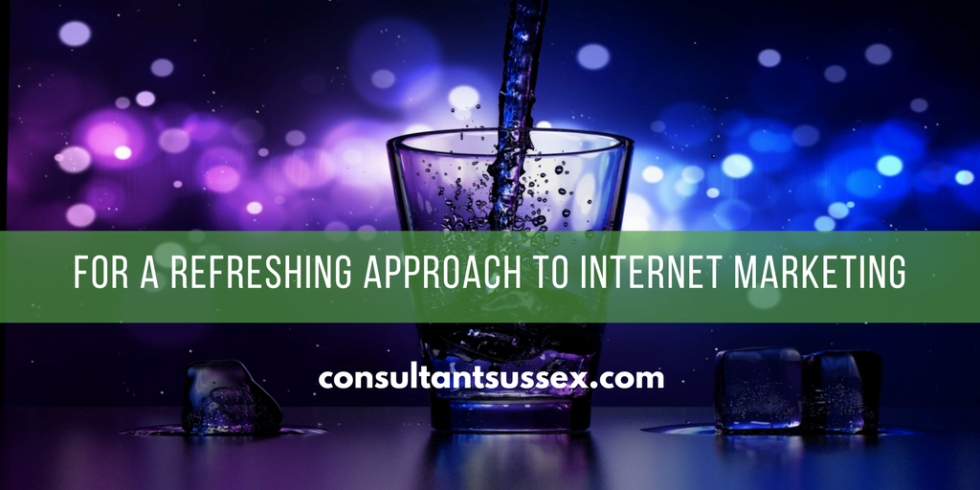 Image of a glass with liquid being poured in it and the text for a refreshing approach to internet marketing