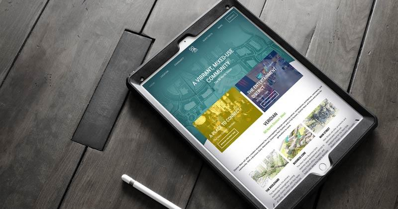Image of iPad on table with website loaded on it