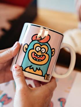 Coffee mug new hires receive in their onboarding package
