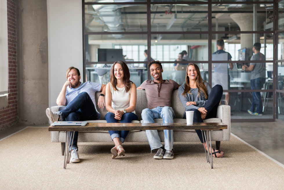 A group of Mailchimp employees sitting on a couch