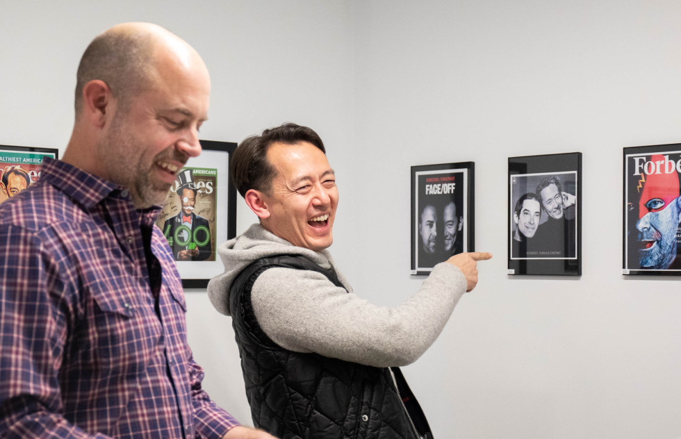 A photograph of Ben and Dan looking at the employee art