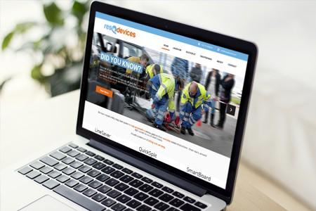 Photo of laptop screen open to custom website design