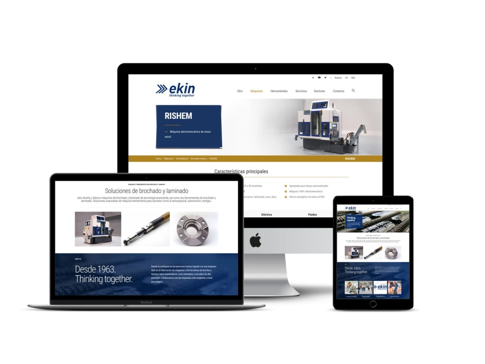 Homepage website shown in Apple desktop, Macbook, and tablet versions. The larger desktop includes an all white background with dropdown headers to other links and the brand logo. The top half also includes a photo of machinery. The Macbook and Tablet versions' backgrounds are split with a top half white background and a navy blue bottom half background. The top half includes photos of machinery and other industrial products with supporting text.