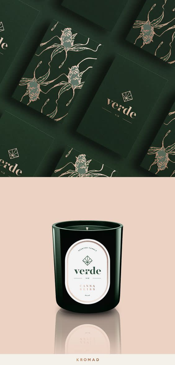Rectangular image split evenly in half. Top half includes dark green background with several branded cards evenly lined up at an angle. Two cards are fully visible with different designs. On the left side, dark green card is covered in white tasteful designed doodles. The right card has logo in white in center of the card. Bottom half has light pink background with candle in the center. Candle is green with logo in white and it looks like it's reflected back in the light pink background underneath it.