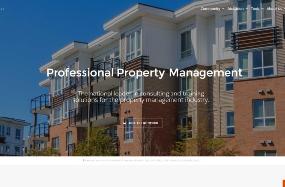 Website homepage featuring background image of condos against blue sky. Image is slightly faded and has text in center overlaying it. Links in top right corner and one link below center text.