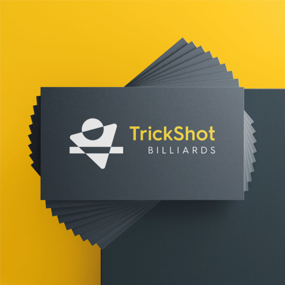 Image of business cards stacked with the text trickshot billiards.