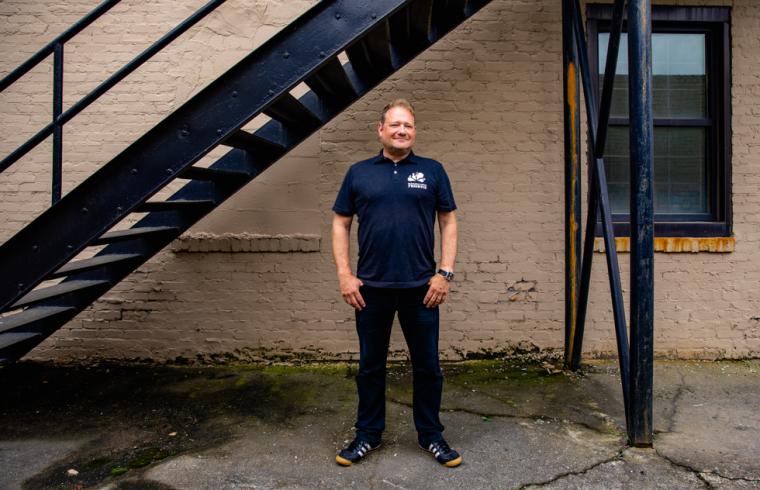 Freshtix Co-founder Iain Bluett standing and smiling outside of the Freshtix office.