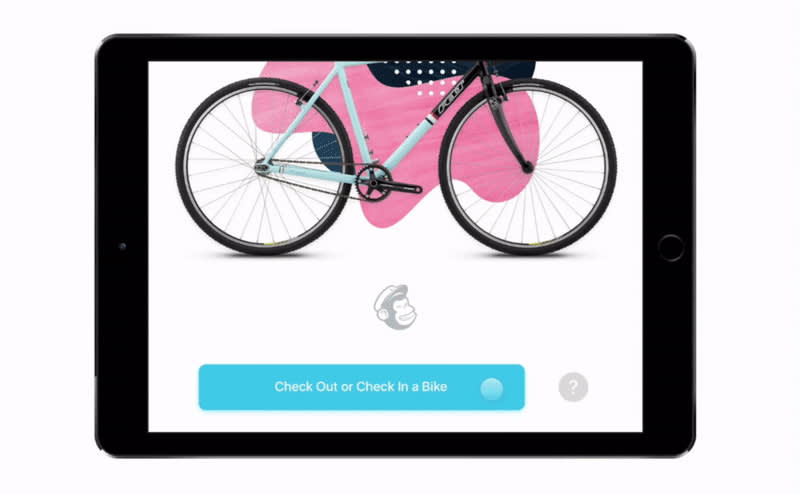 An iPad displaying the Mailchimp Bike Share App