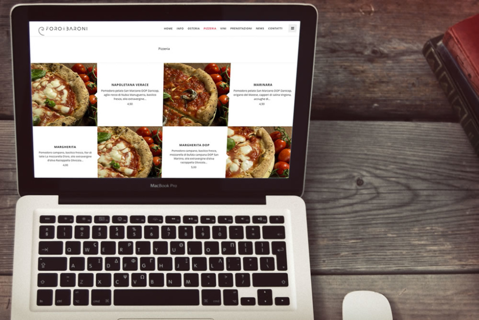 Image of Laptop on table with pizza images on it