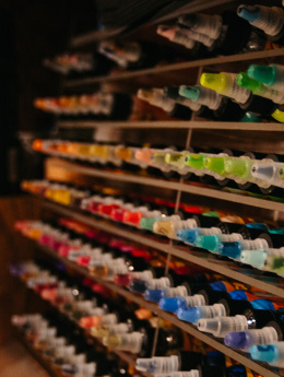 A bunch of ink bottles in a tattoo parlor