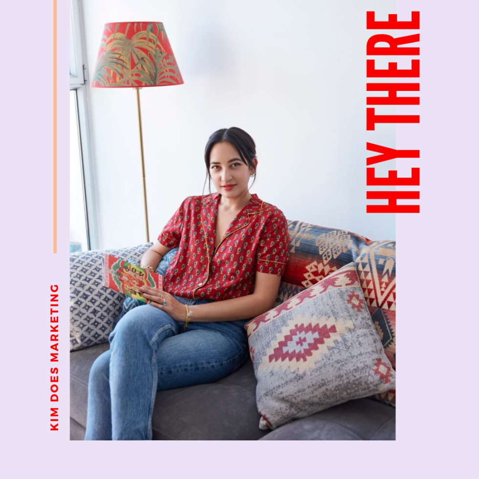 Image of a person on a couch and the text hey there and kim does marketing