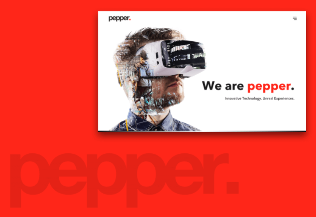 "Image of a man wearing a virtual reality headset with words ""we are pepper."""