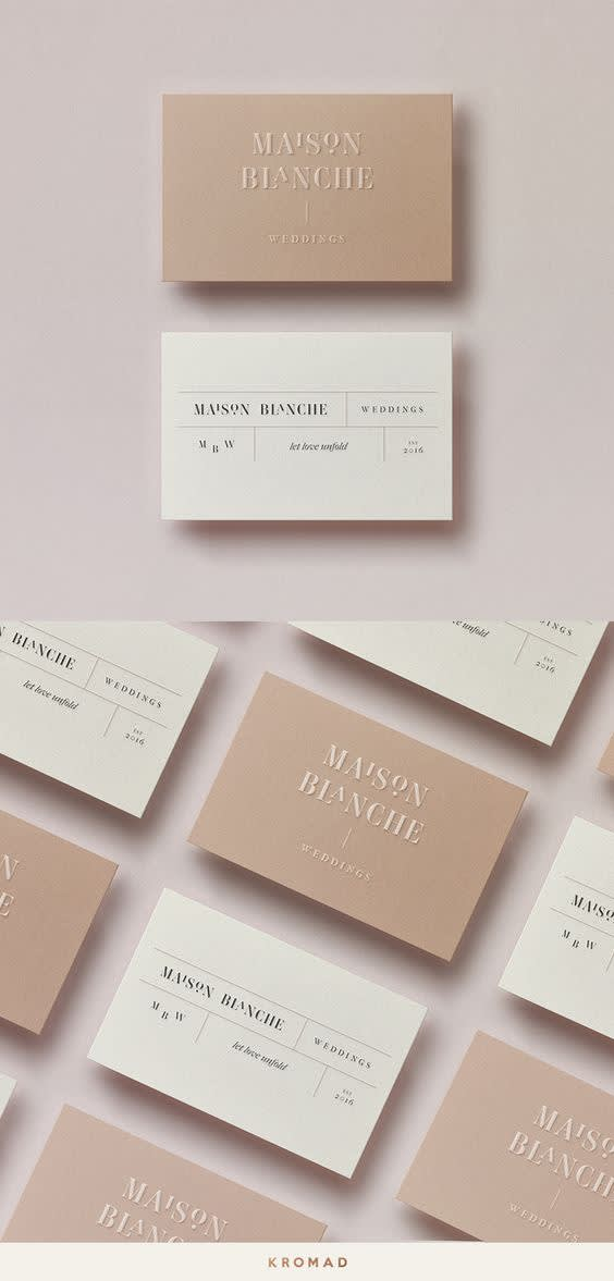 Rectangular image split evenly in half. Top half has light pink background with two cards at the center vertically aligned. Top card is a light brown shade with logo stenciled at center top. Bottom card is a white and/or light beige color with another branding design.