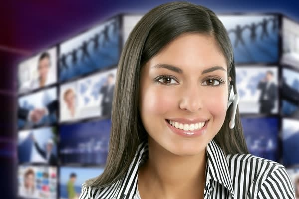 Image of person with a headset smiling