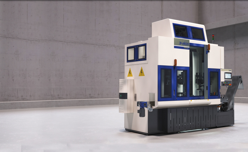 Image of large machine alone in a gray room. Machine is very industrial looking and it's white and blue and black.