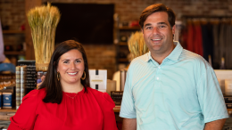 TJ Callaway and Virginia Johnston of Onward Reserve stand beside each other in their Buckhead store. They are smiling at the camera.