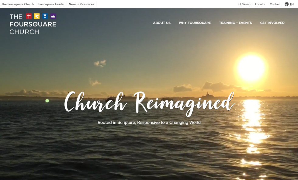 "Website homepage screenshot for a church. Logo in top right corner along with white text hyperlinks placed vertically in top left. Background image of sunset on the ocean makes up entire homepage. In the center, white text in cursive font overlays image, ""Church Reimagined"". Supporting text in smaller font and not cursive underneath."