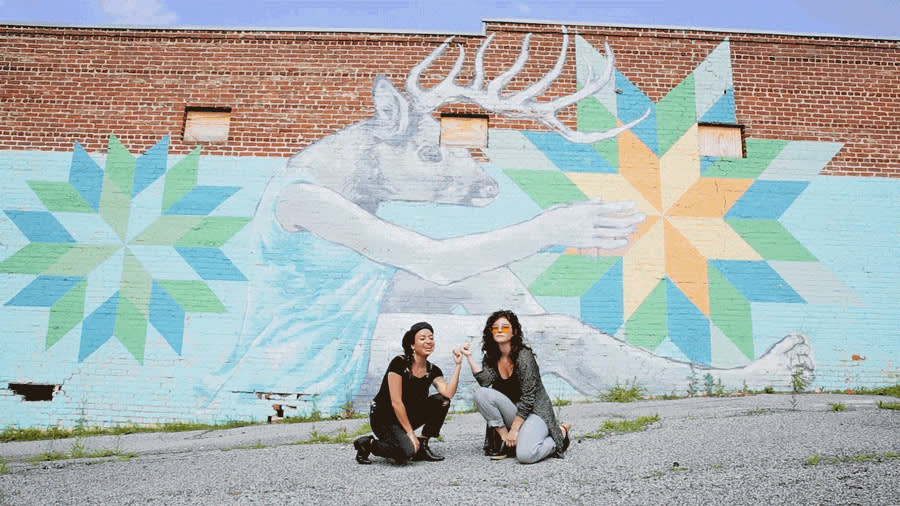 Monica Campana, co-founder of Living Walls, and her trusty sidekick (actual title: executive assistant), Kristen Consuegra