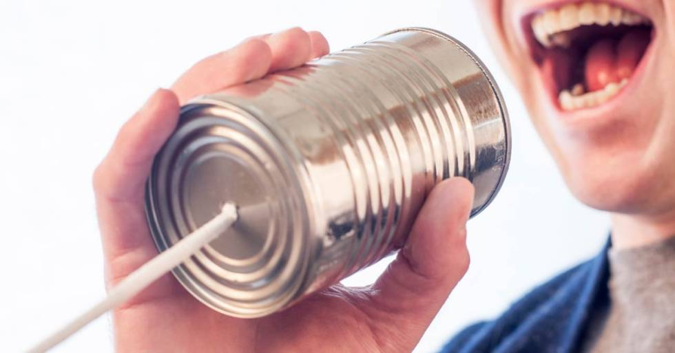 Image of person talking into can with string telephone