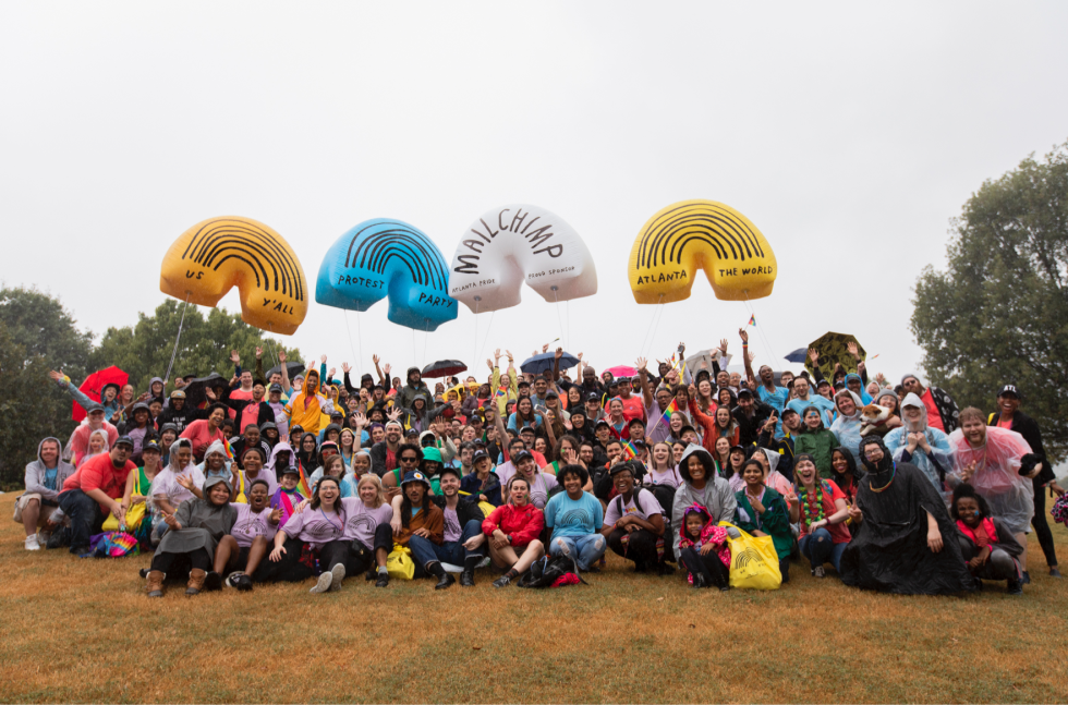 Mailchimp employees posing for a group photo at the end of the Atlanta Pride Parade in Piedmont Park.