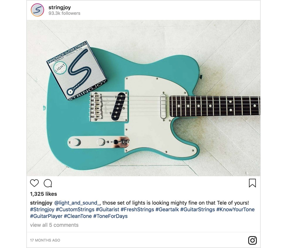 An Instagram post from Stringjoy featuring a guitar and pack of guitar strings
