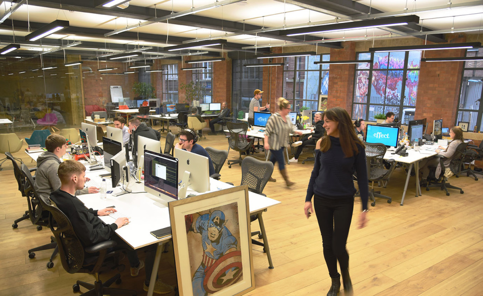 Photo of Effect Digital Office employees at their desks