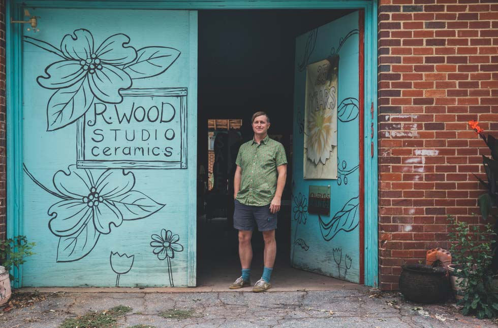 R. Wood Studio Manager Josh Skinner stands outside the studio.