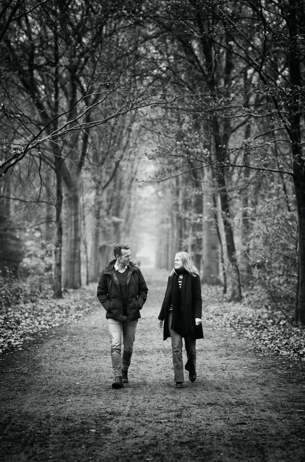 Image of two people walking in a forest