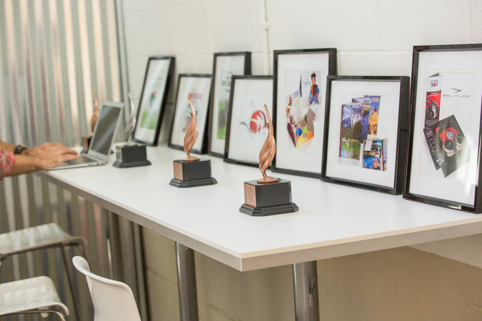 Image of table with awards for the Brandon Agency.