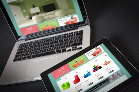 Laptop and tablet showing different versions of same example website design