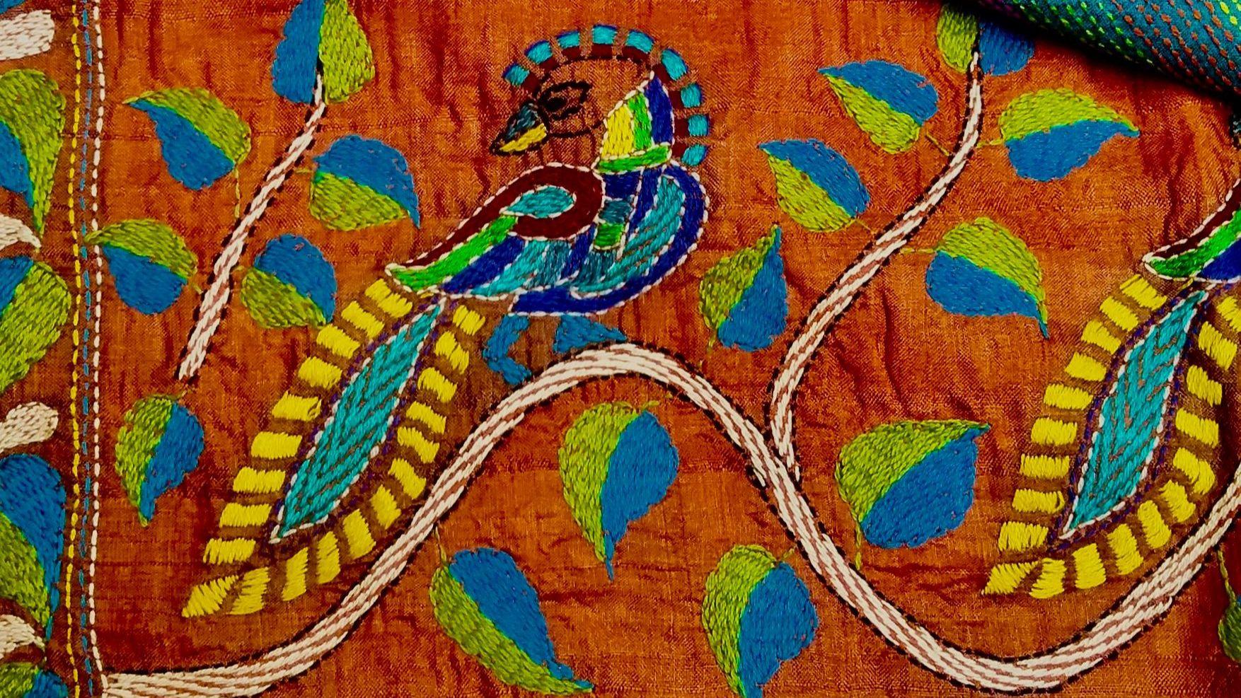 Oiseau de paradis sur soie orange